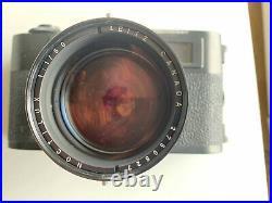 Set fotografico Leica M5, con Noctilux 11 e Tele-Elmar 135 paraluce e borsa