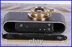 Vintage camera Leica D. R. P 35 mm Leitz Elmar lens f = 5, 13.5 Wooden Edition